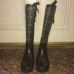Lightly worn brown lace up coach rain boots.